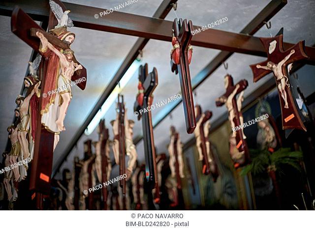 Crucifixes handing on beams in shop