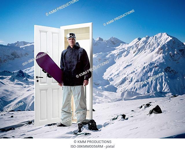 Man emerging from door on mountain