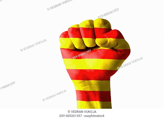 Fist painted in colors of catalonia flag