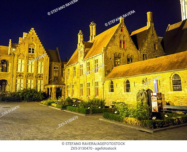 The historic buildings of the former hospital Saint John's Hospital (Site Oud Sint-Jan) by night - Bruges, Belgium
