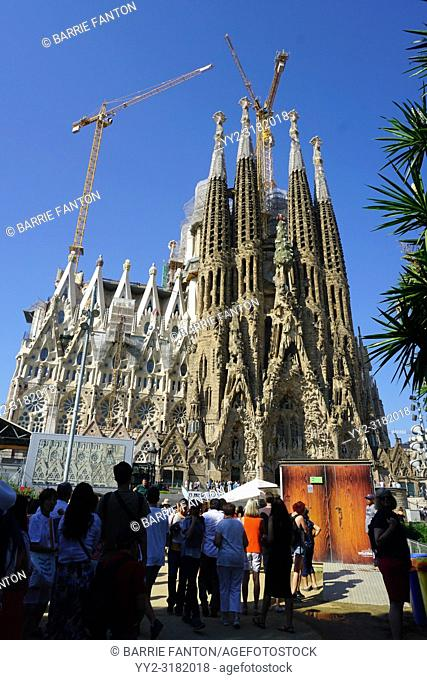 Tourists Looking at Sagrada Familia During Continued Construction, Barcelona, Spain