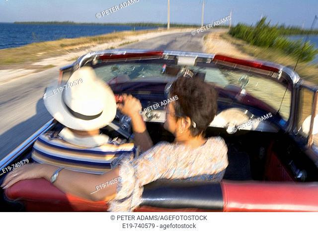 Couple in 1950 Chevrolet convertible, Cuba