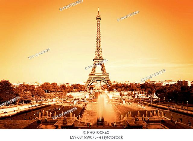 Eiffel Tower seen from fountain at Jardins du Trocadero, Paris, France. Vintage, monochrome gold