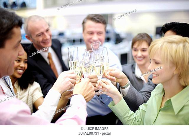 Group of business people toasting with champagne