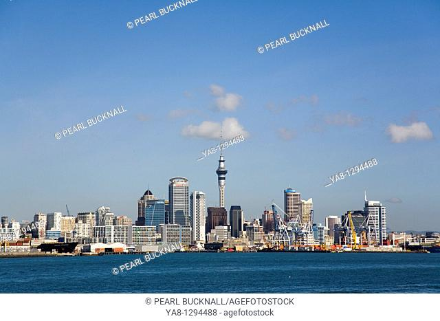 Auckland North Island New Zealand  Central Business District skyline Sky Tower and international container ports on eastern waterfront from across Waitemata...