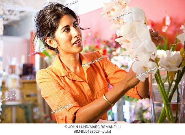 Hispanic florist working in flower shop