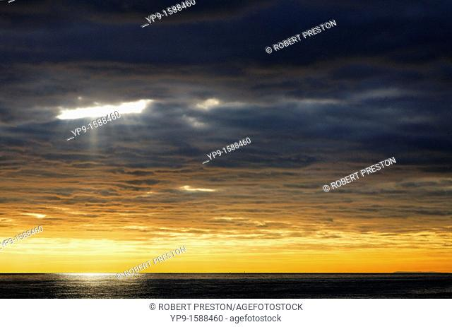 Sunlight and clouds over the sea, East Sussex, England