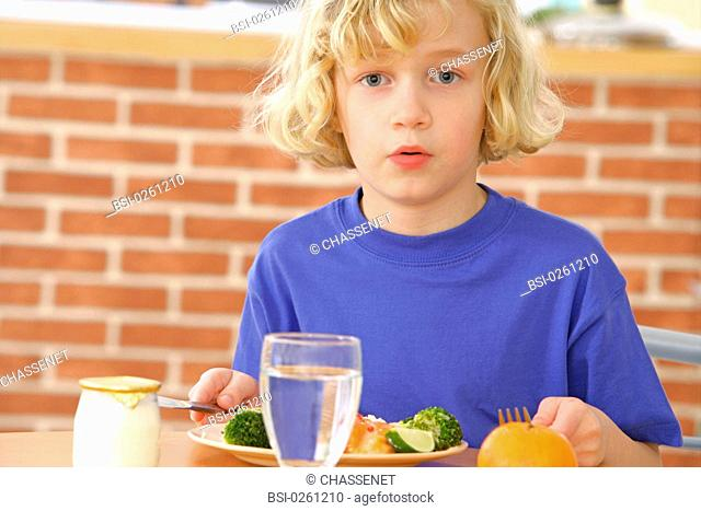 CHILD EATING FISH
