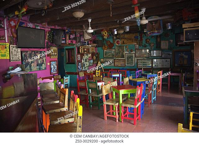 Colorful tables and chairs in a bar at the historic center, Cartagena de Indias, Bolivar, Colombia, South America