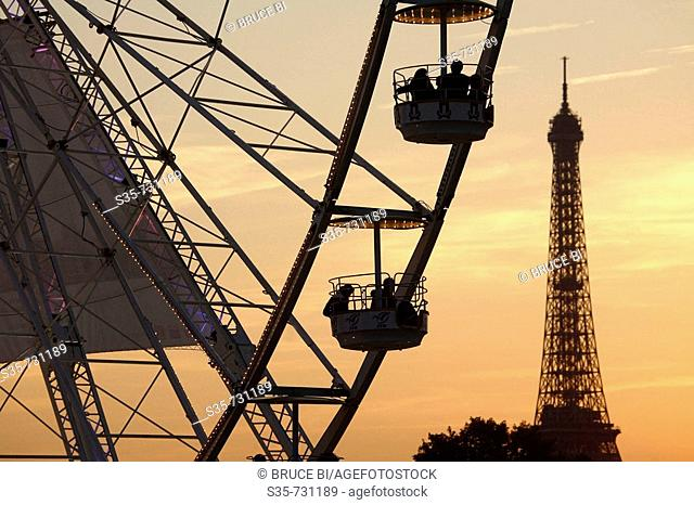 France. Paris. The view of the ferry wheel in Palace de la Concorde with Eiffel Tower in the background after sun set