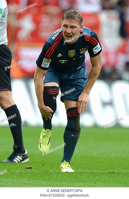 Munich's Bastian Schweinsteiger touches his leg during the German Bundesliga match between FSVMainz and FCBayern Munich at Coface Arena inMainz,Germany