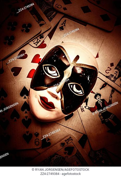 Fortune telling concept on a gypsy porcelain face on tarot playing cards. Psychic readings