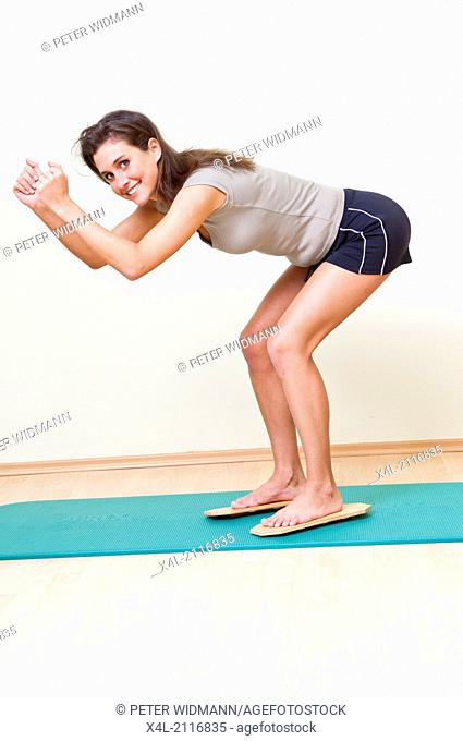 young woman in squat, ski training (model-released)