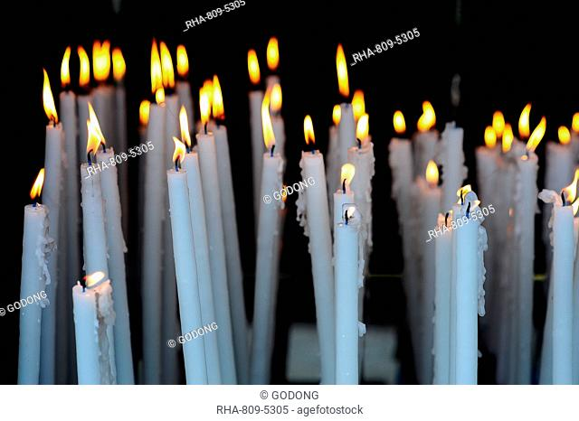 Altar candles in the Cave where Bernadette Soubirous had her Marian apparitions of our Lady of Lourdes in the French town of Lourdes, Hautes-Pyrenees, France
