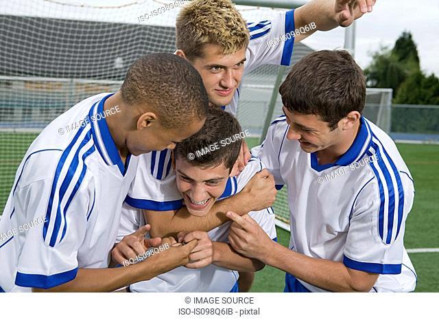 Footballers celebrating