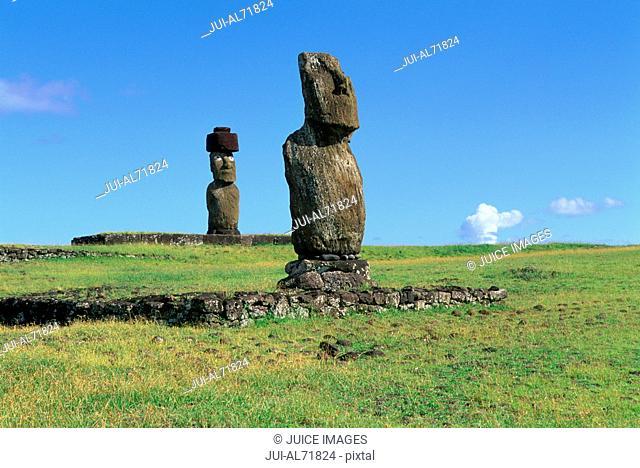 View of moai statues against blue sky, Chile, Easter Island (Rapa Nui)