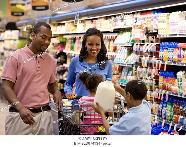 Family shopping together in grocery store