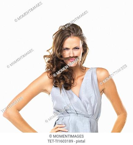 Studio portrait of playful woman with moustache made of hair
