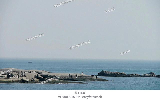 Ocean water surface and rock reef coastal,Tourists,visitors,ebb,horizon,skyline