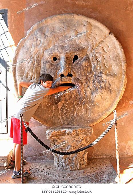 young teenager puts his hand inside the Bocca della Verit?, Rome
