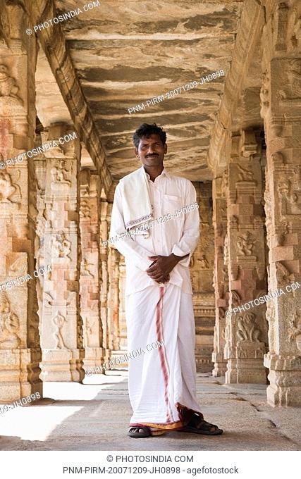 Man standing in a temple, Krishna Temple, Hampi, Karnataka, India