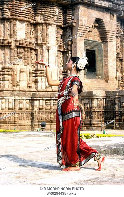 Dancer performing classical traditional odissi dance at Konarak Sun temple , Konarak , Orissa , India MR 736C