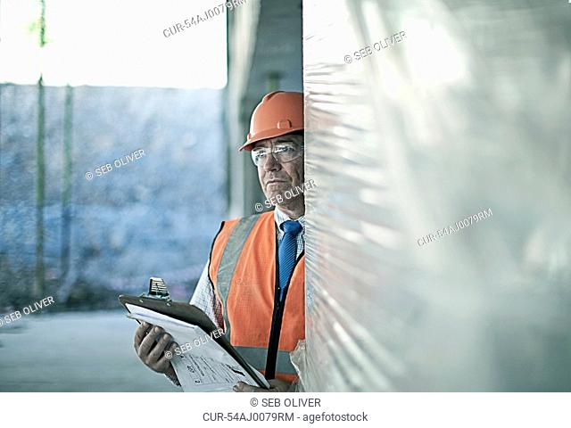 Businessman standing on construction site