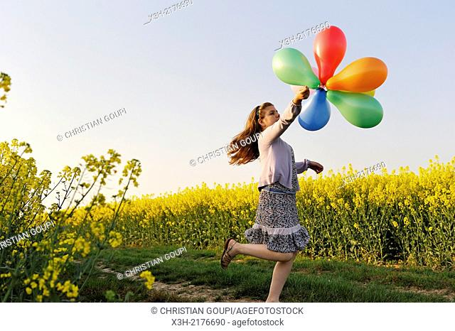 little girl playing with balloons in the fields, Eure-et-Loir department, Centre region, France, Europe