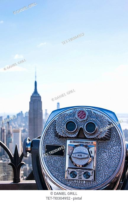 Coin operated binoculars with Empire State Building in background