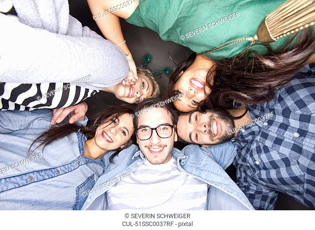 Friends smiling together in circle