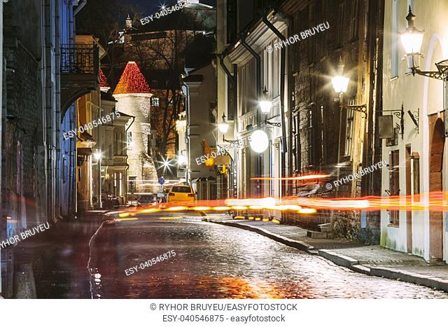 Tallinn, Estonia. Traffic Lights Trails In Night Street Near Famous Landmark Viru Gate In Street Lighting At Evening Illumination