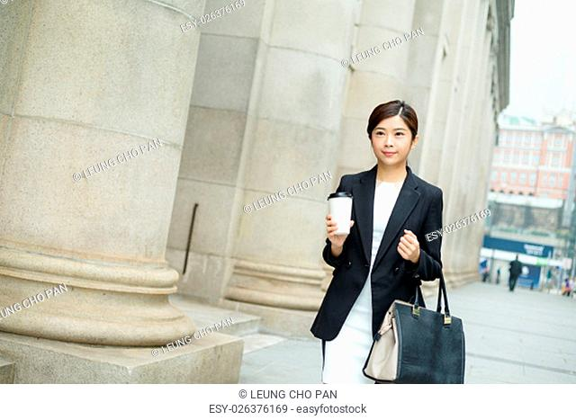 Businesswoman walking at the street