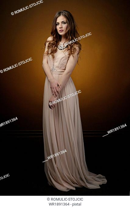 Young Woman Wearing Evening Gown