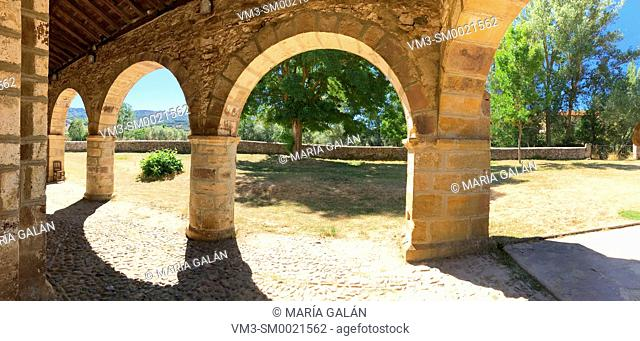 Portico of the Romanesque church, panoramic view. San Salvador de Cantamuda, Palencia province, Castilla Leon, Spain