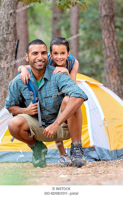 Portrait of young man and girl camping in forest, Sedona, Arizona, USA