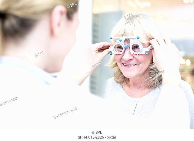 Senior woman having eye exam by optometrist