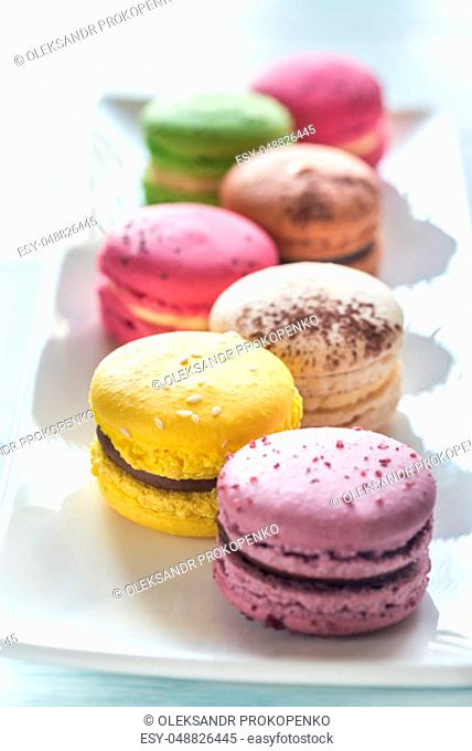 Colorful macarons on the white plate