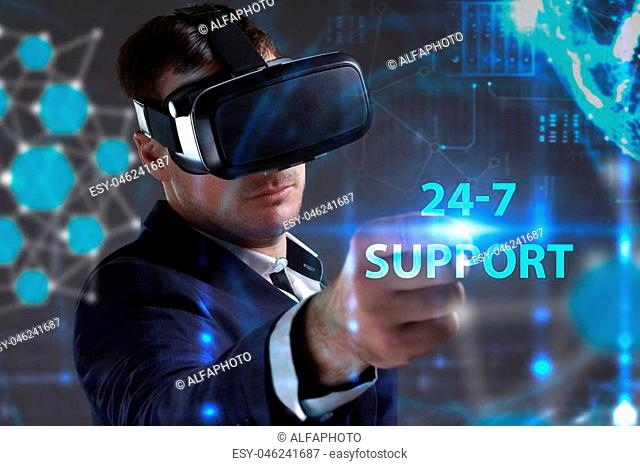Business, Technology, Internet and network concept. Young businessman working in virtual reality glasses sees the inscription: 24-7 Support