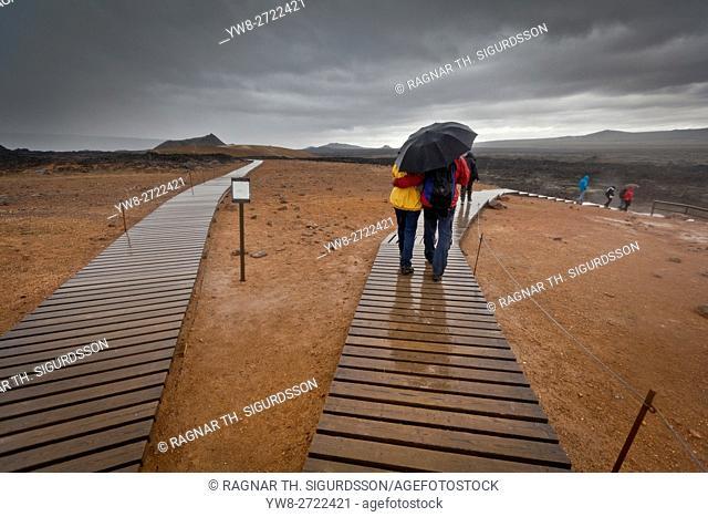 Tourists on walking paths, Leirhnukur hot spring area, near the Krafla Volcano, Northern Iceland
