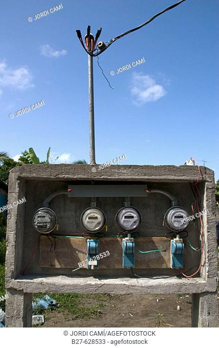 Electric meters at Tortuguero village. Tortuguero National Park. Atlantic Coast. Costa Rica. Central America