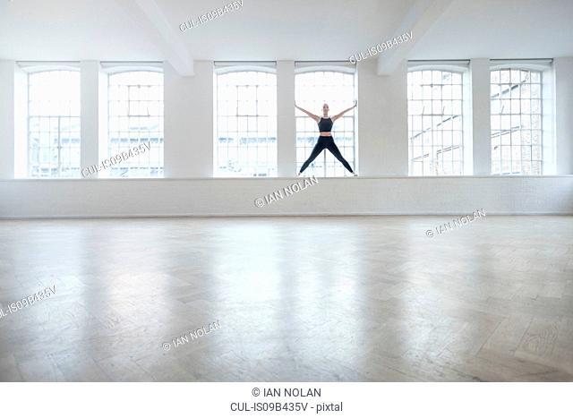 Woman on windowsill in dance studio