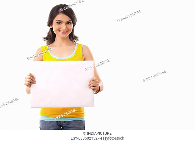 Portrait of a young Woman point to blank sign