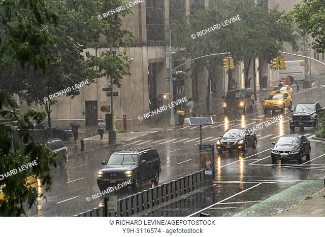 A torrential downpour disrupts the New York neighborhood of Chelsea on Tuesday, July 17, 2018. There is a flash flood warning in the city as a slow moving...