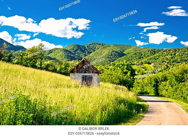 Landscape of green Zumberak hills with old stone cottage, northern Croatia
