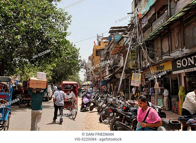Shops line a street in the Chandni Chowk Market in Old Delhi, India. Chandni Chowk is Asia's largest wholesale market. Legend has it that Mughal emperor Shah...