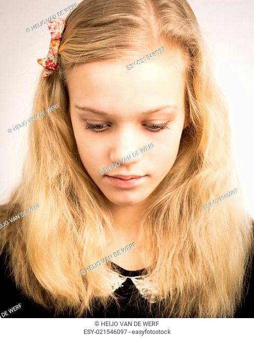 Beautiful Blond Teenage Girl Looking In The Camera