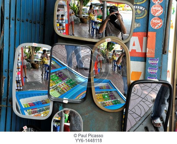mirrors , reflection, portrait  Photographer taking a weird photo, chinatown , bangkok, thailand