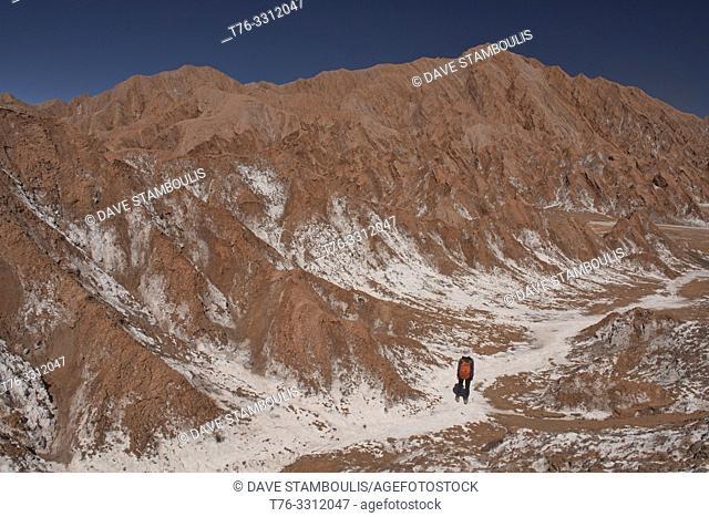 Trekking in the salt mountains in the Valle Marte, San Pedro de Atacama, Chile