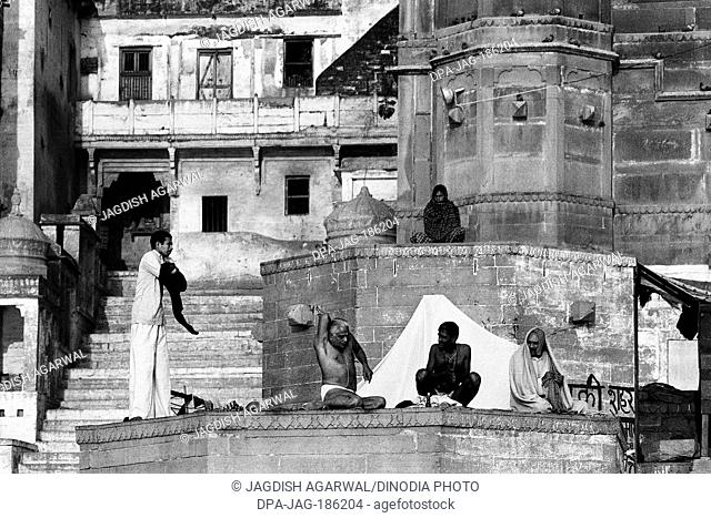 Sadhus praying on Ghats of river Ganges Varanasi Uttar Pradesh India Asia 1982