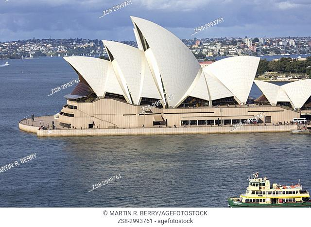 Sydney Opera house at Bennelong Point, Sydney, Australia with a Sydney passenger ferry passing by